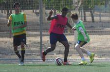 Thumbnail les footballeurs de l'ISC Spain en plein match en Espagne.